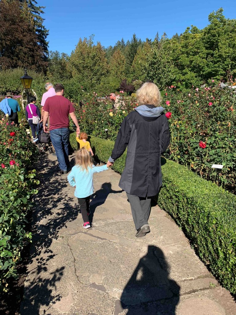 Walking hand-in-hand through rose gardens.