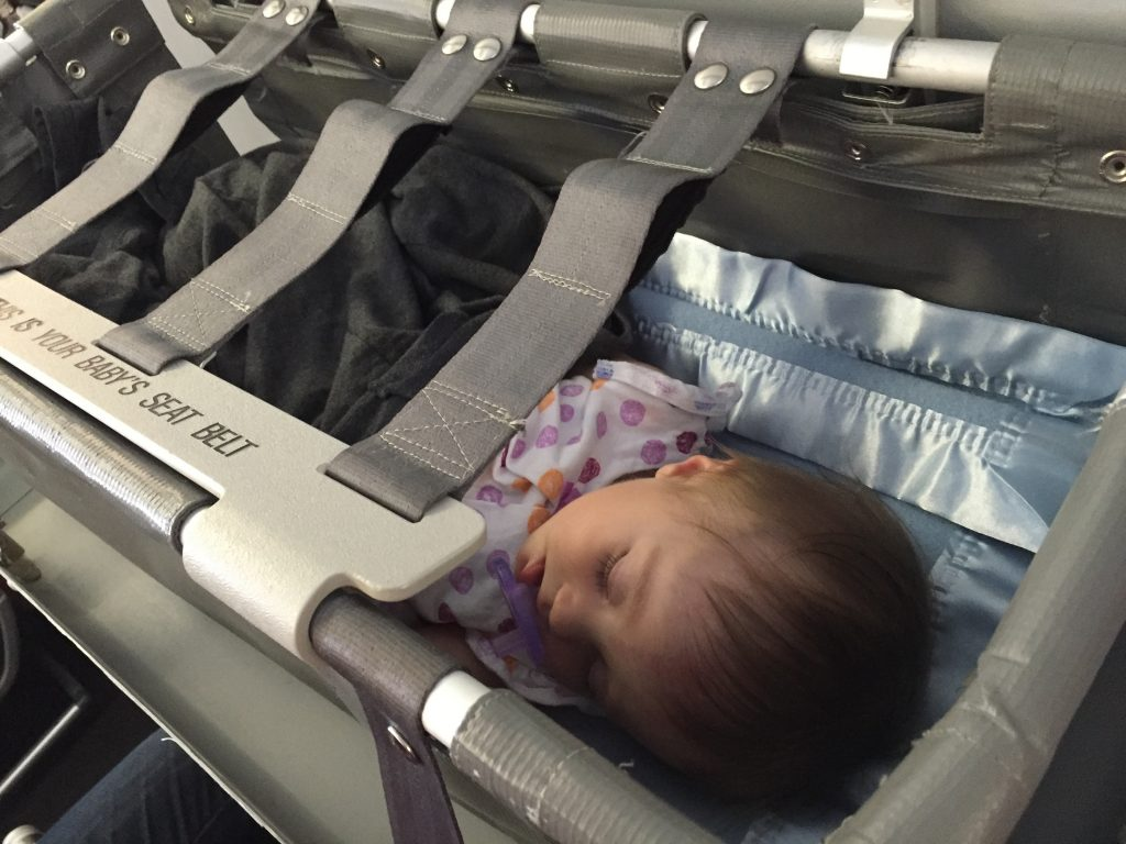 Goodbye Sydney! Lizzy asleep in the airplane bassinet. Unfortunately, this only lasted 30 minutes.