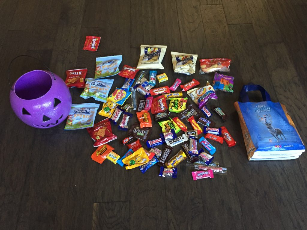 Our candy haul. This was more than enough for little Lizzy. Disneyland Halloween Party