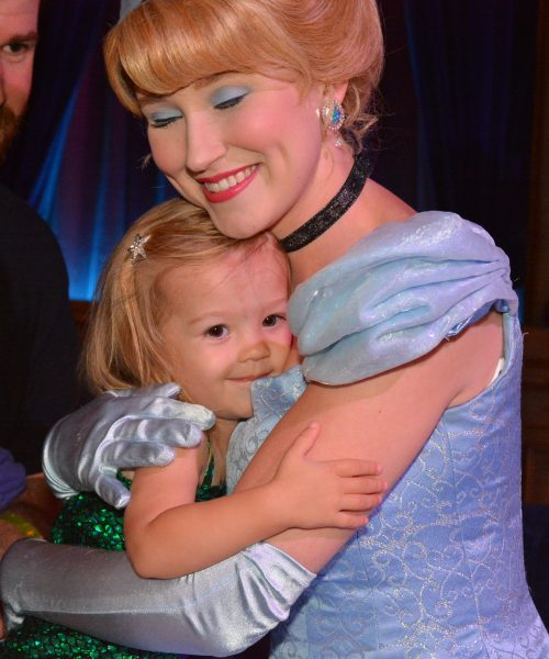 She finally got brave enough to hug Cinderella.